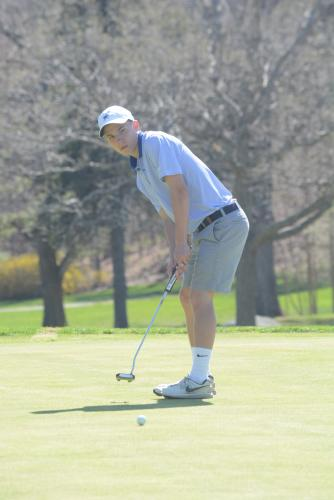 David Brestovansky watches his putt roll toward the cup. (Bee Photo, Hutchison)