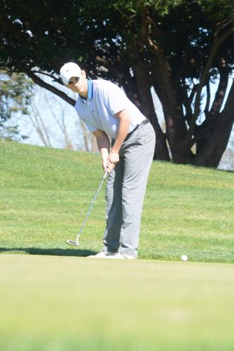 Mike Meyer watches his putt during a match this spring. (Bee Photo, Hutchison)