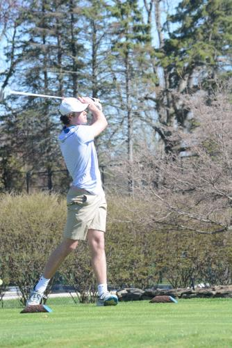 Ryan Kost tees off during an early-season match. (Bee Photo, Hutchison)