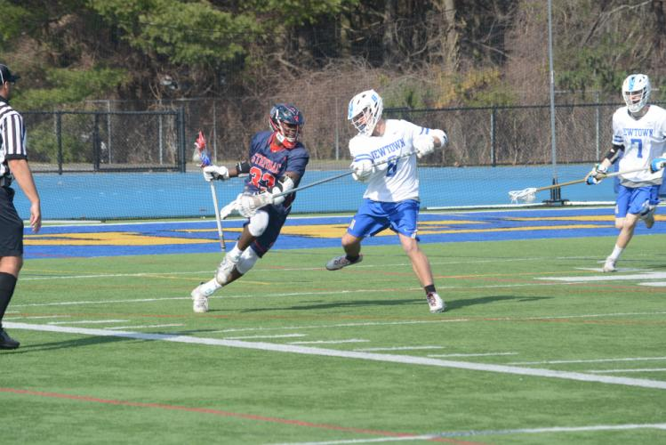 Tyler Rising, right, defends during Newtown's game against Stepinac. (Bee Photo, Hutchison)