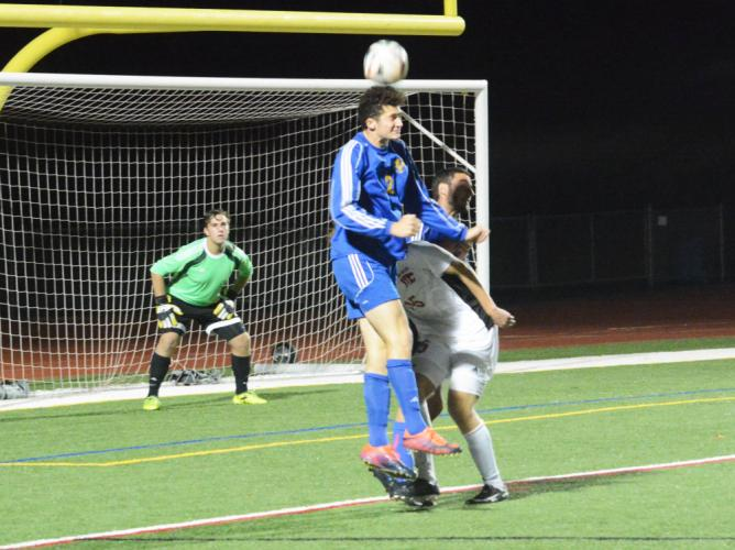 Grant Moxham gets his head on the ball. Goalkeeper CJ Trivers looks on. (Bee Photo, Hutchison)