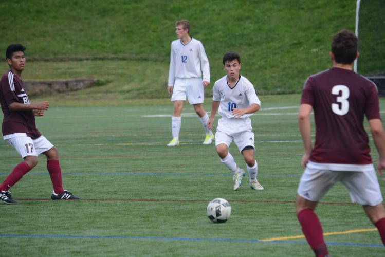 Owen Baillargeon moves the ball against Bethel. Baillargeon, in Newtown's next game, scored twice in a 2-0 win over New Fairfield. (Bee Photo, Hutchison)