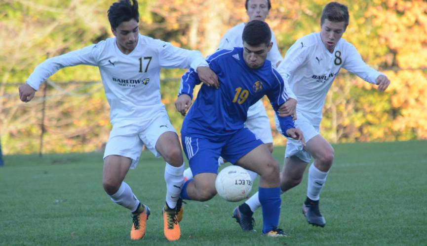 Rilind Limani (No. 19) battles with Barlow players during a win on October 12. Limani scored the go-ahead goal against Immaculate and assisted a goal in a 1-0 win over Barlow. (Bee Photo, Hutchison)