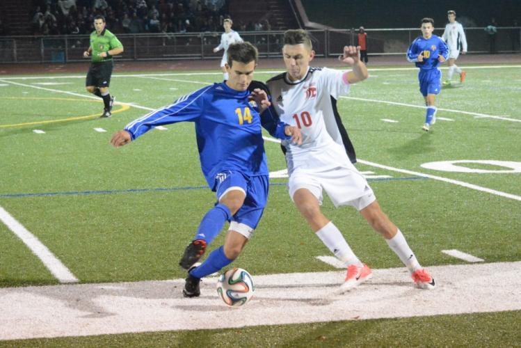 Newtown's Tom Shkreli, left, and Masuk's Ryan Hodska go for the ball. (Bee Photo, Hutchison)