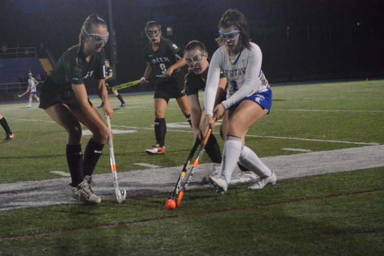 Emma Schmid-Tharnish keeps the ball on her stick as New Milford players defend. (Bee Photo, Hutchison)