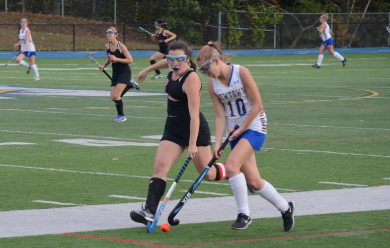 Katherine Trammel, right, fends off a Warde player. (Bee Photo, Hutchison)