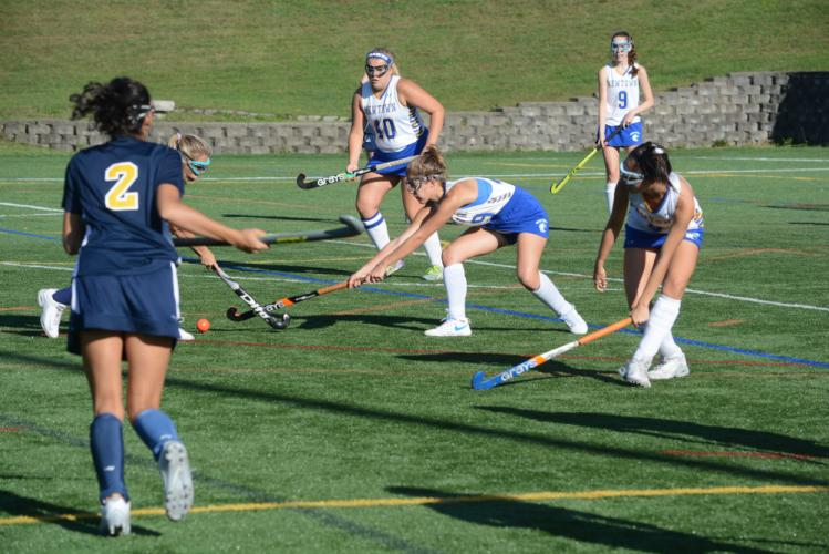 Camryn Griffin gets her stick on the ball as teammates Olivia Butler (No. 40), Katie Basset (No. 9), and Hana Rosenthal join the play. (Bee Photo, Hutchison)