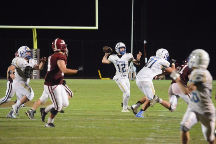 QB Ryan Kost throws a pass on the run. (Bee Photo, Hutchison)