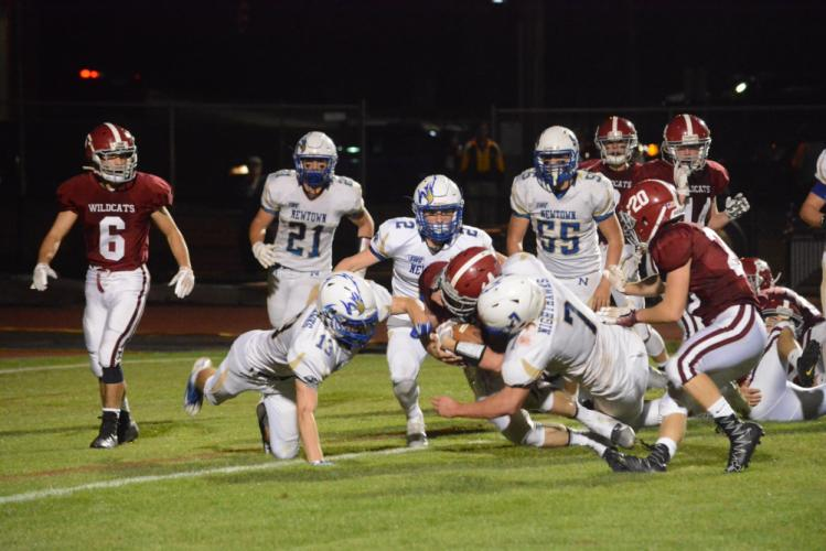 Newtown's defenders swarm a Bethel ball carrier. (Bee Photo, Hutchison)