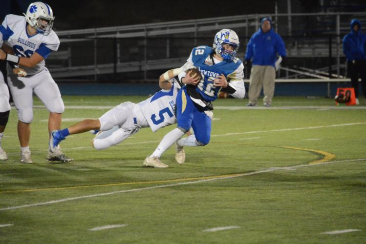Quarterback Ryan Kost is tackled by a Bunnell player. (Bee Photo, Hutchison)