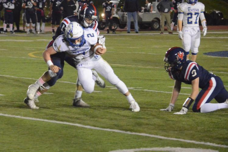 Joe Pagett, being tackled, had two TD catches in the win. (Bee Photo, Hutchison)