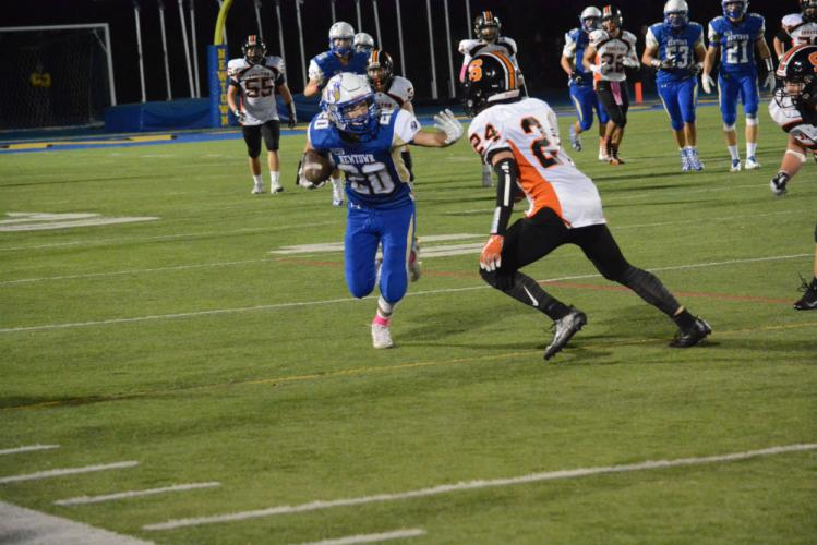Riley Ward rushes past a Shelton defender. (Bee Photo, Hutchison)