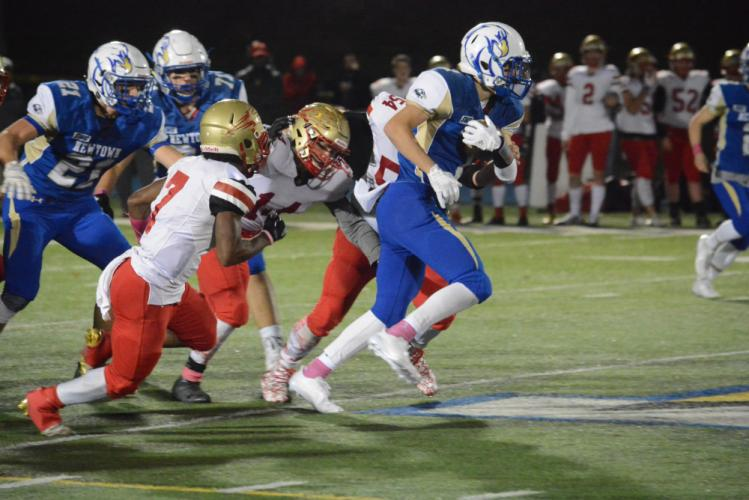 Griffin Cross carries the ball as Stratford defenders go for the tackle. (Bee Photo, Hutchison)