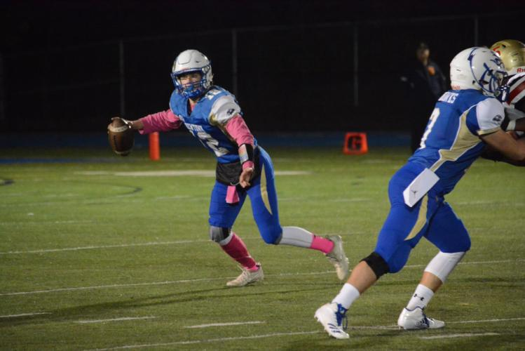 Ryan Kost scrambles before throwing a pass. (Bee Photo, Hutchison)