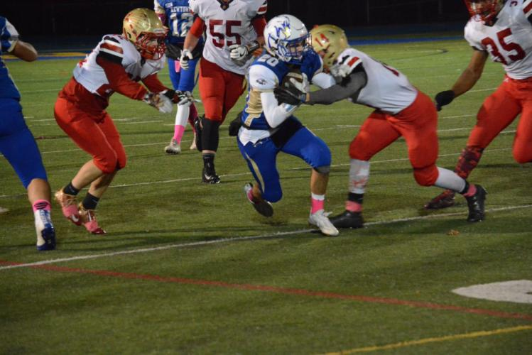 Riley Ward tries to break a tackle after a reception. (Bee Photo, Hutchison)