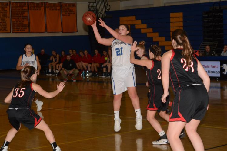 Nicki DaPra makes a pass during Newtown's game with Pomperaug, on December 21. (Bee Photo, Hutchison)