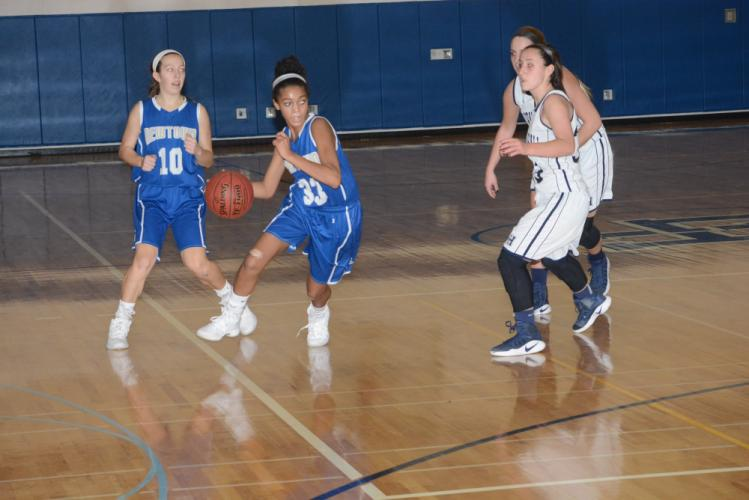 Amy Sapenter makes a move around defenders as Cyleigh Wilson looks on. (Bee Photo, Hutchison)