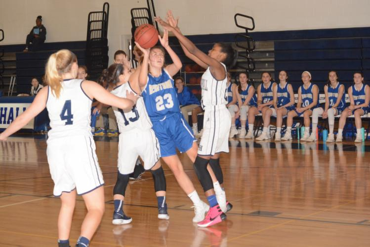 Greta Staubly goes up in the paint while under pressure. (Bee Photo, Hutchison)