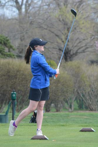 KIra Kelly watches her shot during a match at Rock Ridge. (Bee Photo, Hutchison)