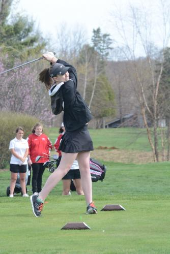 LIz Weisgerber follows through on her swing at the first tee. (Bee Photo, Hutchison)