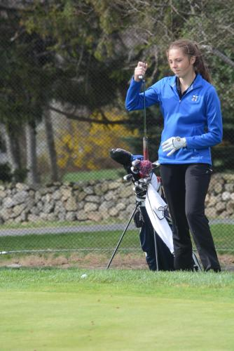 Sarah Houle selects a putter during action at Rock Ridge Country Club earlier this spring. Houle was the medalist for the Hawks in the SWC championship. (Bee Photo, Hutchison)