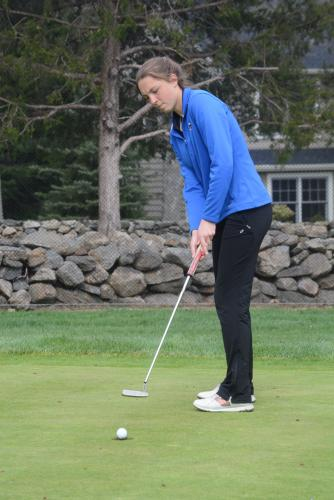 Sarah Houle sinks a putt during Newtown's win at Rock Ridge Country Club on April 17. (Bee Photo, Hutchison)