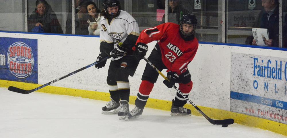 Catie Gregory, a Newtown High player on the Masuk-led team, moves the puck out of corner during a 5-1 win over Trumbull-St Joseph, at The Rinks at Shelton, on January 22. (Bee Photo, Hutchison)