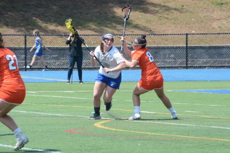 Alex Futterman moves around a defender during a game against Ridgefield this spring. (Bee Photo, Hutchison)