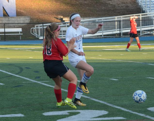 Carly Swierbut, right, battles for the ball. (Bee Photo, Hutchison)