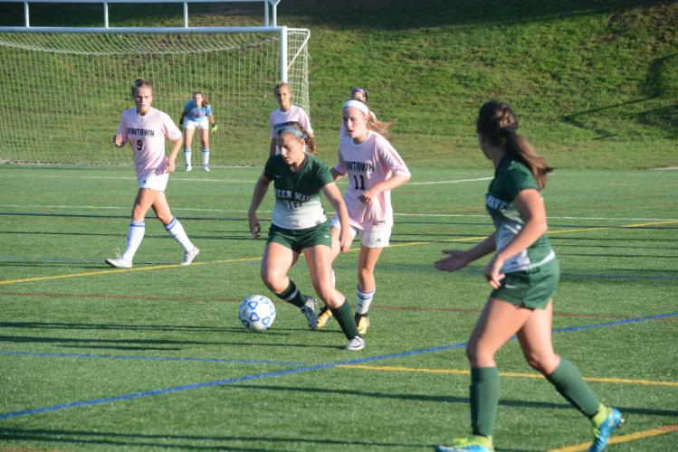 Carly Swierbut, right, defends. Swierbut had three goals against New Milford. (Bee Photo, Hutchison)
