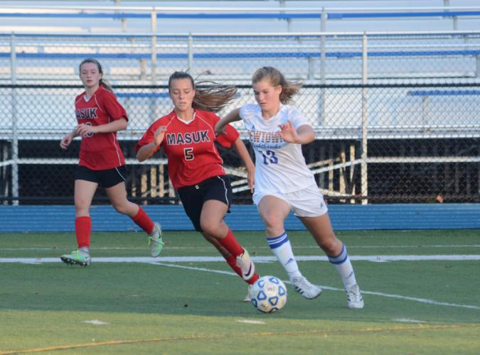 Emma Curtis, right, and a Masuk player compete. (Bee Photo, Hutchison)