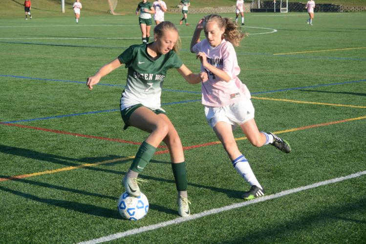 Faith O'Hara, right, battles a New Milford player for the ball. (Bee Photo, Hutchison)