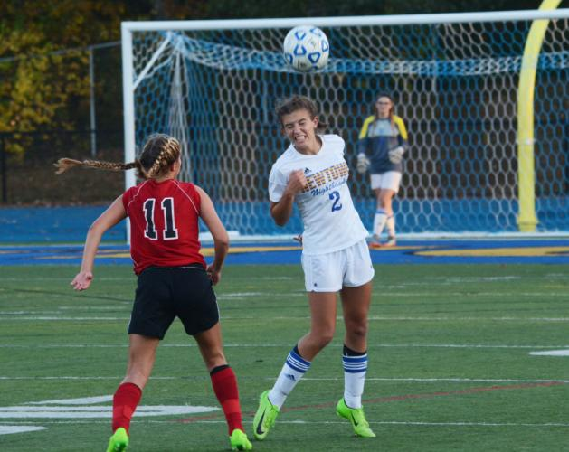 Hannah Daly heads the ball during Newtown's 3-2 win over Masuk. (Bee Photo, Hutchison)