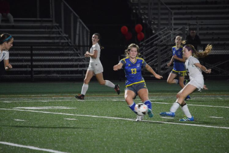 Emma Curtis plays the ball during the SWC title game. (Bee Photo, Hutchison)