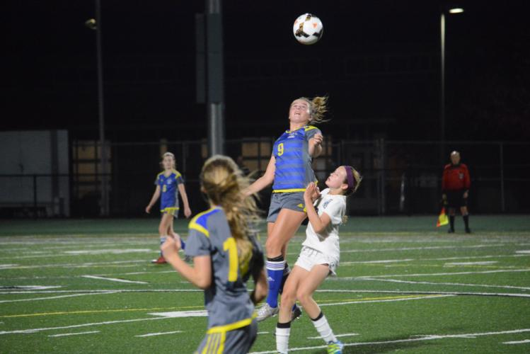 Grace Corcoran elevates to get her head on the ball. (Bee Photo, Hutchison)