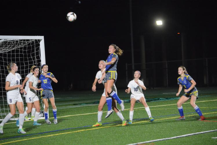 Grace Corcoran heads the ball during the SWC title game. (Bee Photo, Hutchison)
