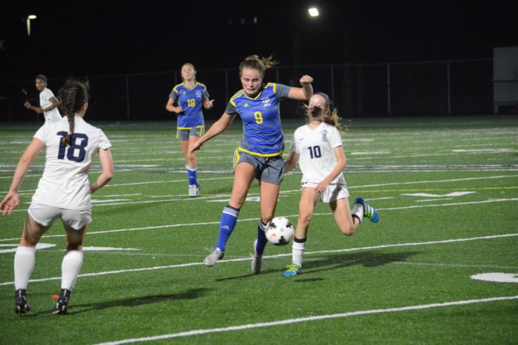 Grace Corcoran (No. 9) battles for the ball this past season. (Bee Photo, Hutchison)