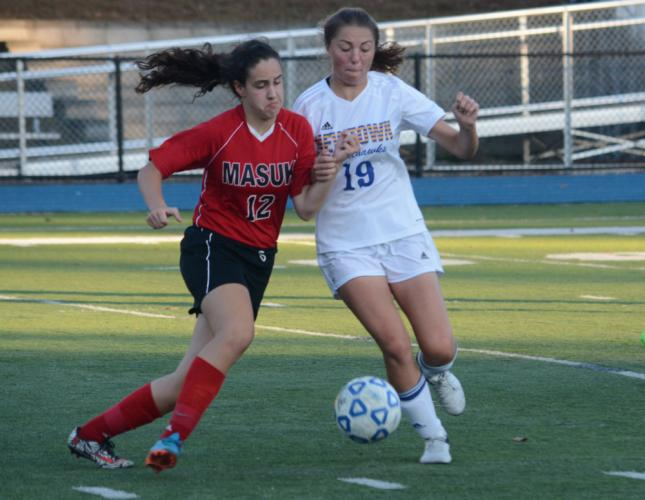 Sarah Houle, right, had a goal and two assists in the win. (Bee Photo, Hutchison)