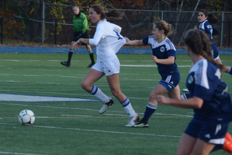 Sarah Houle is fouled by a Wilton player. (Bee Photo, Hutchison)