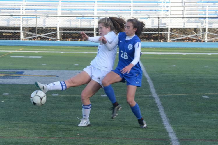 Emma Curtis, left, battles during Newtown's loss to Glastonbury. (Bee Photo, Hutchison)
