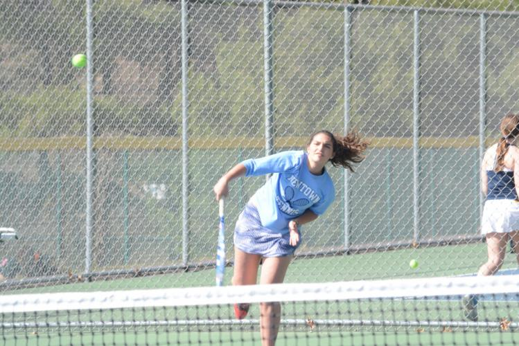 Marie Ann Tomaj puts the ball into play with a serve. (Bee Photo, Hutchison)