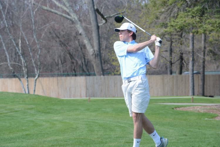 Tim Davis follows through on his swing during an early-season match. (Bee Photo, Hutchison)