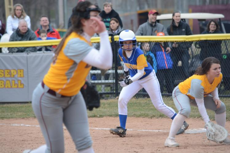 Jackie Moccio takes a throw as a St Joes runner advances to second base. (Bee Photo, Hutchison)