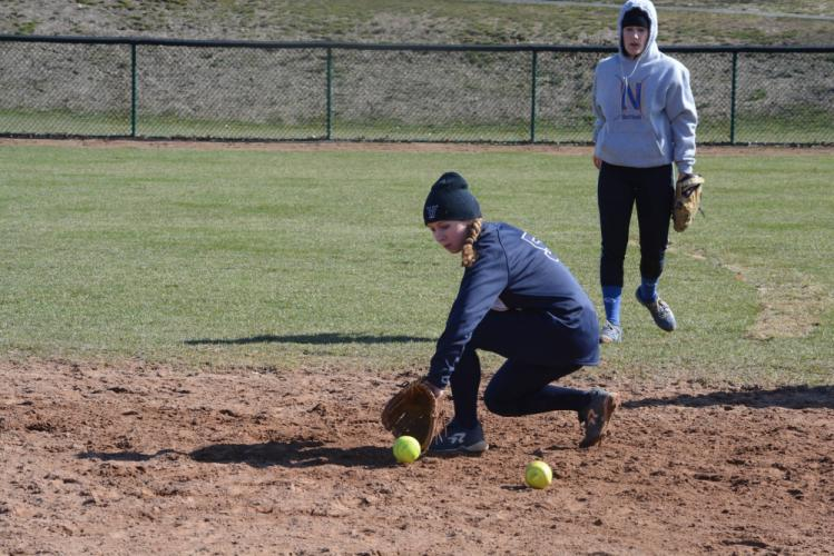 Sara Kennedy throws a pitch as shortstop Mali Klorczyk gets into position during the Masuk game. Kennedy no-hit New Fairfield then battled to win over Masuk in a pair of late-season games. (Bee Photo, Hutchison)