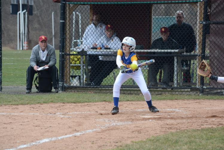 Sienna Cummings drops down a bunt. (Bee Photo, Hutchison)