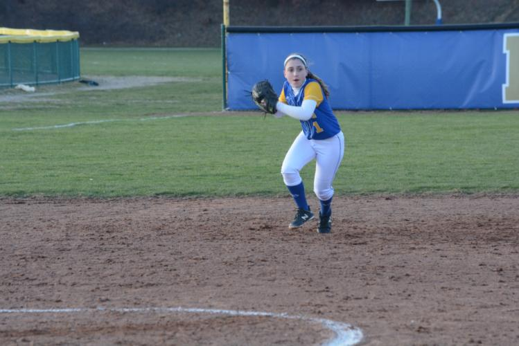 Tess Mubarek throws to first after fielding a grounder. (Bee Photo, Hutchison)