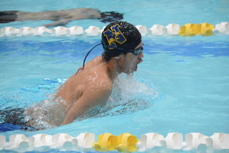 Kevin Tran races in the 100 yard breaststroke race during the SWC championships. (Bee Photo, Hutchison)