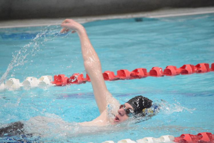 McKinley Seaver races in the backstroke event. (Bee Photo, Hutchison)