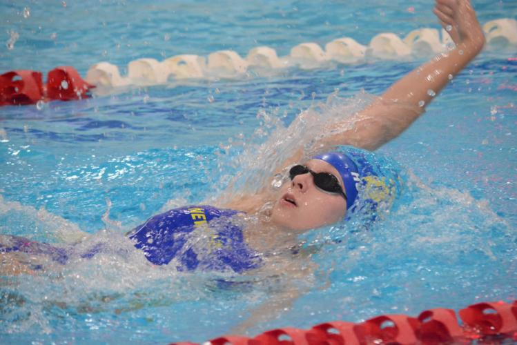 Mary Hufziger competes in the backstroke event against Masuk. (Bee Photo, Hutchison)