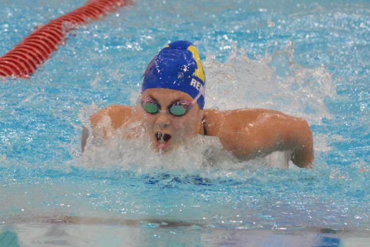 Olivia Renkert races in the 100 butterfly event. (Bee Photo, Hutchison)